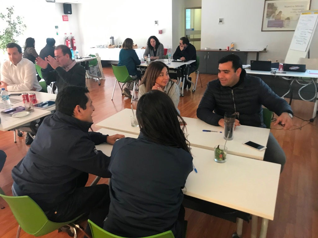 Clorox Chile employees sit around tables