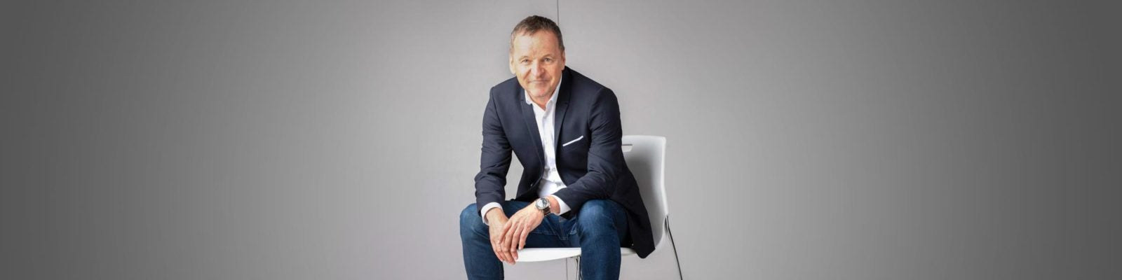 Clorox chair and CEO Benno Dorer sits in a chair