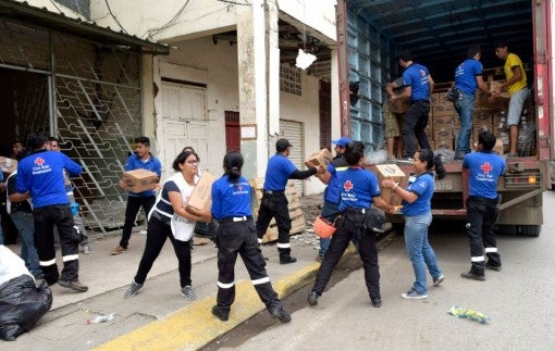Ecuador earthquake - unloading a truck of Clorox bleach