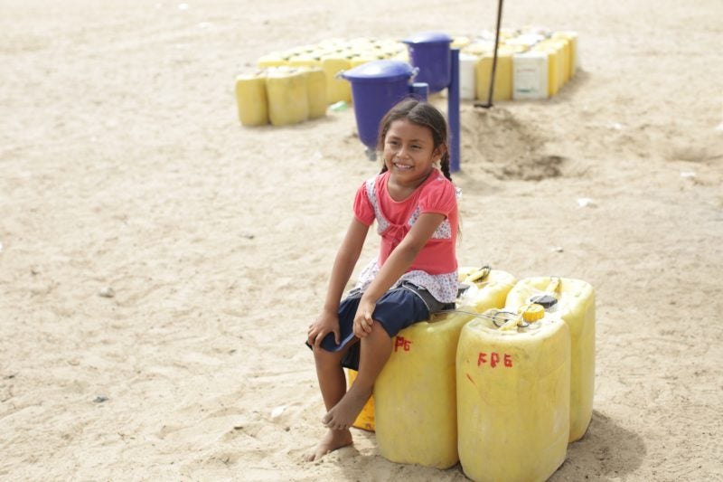 safe-water-peru_child-with-water-containers