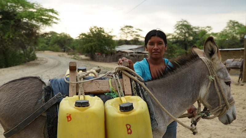 safe-water_peru_collecting-water-with-donkey