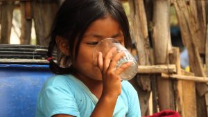 Sara drinking clean and safe water